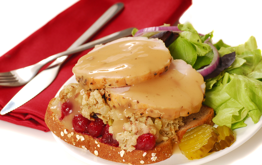 Open faced turkey sandwich with dressing and cranberry sauce