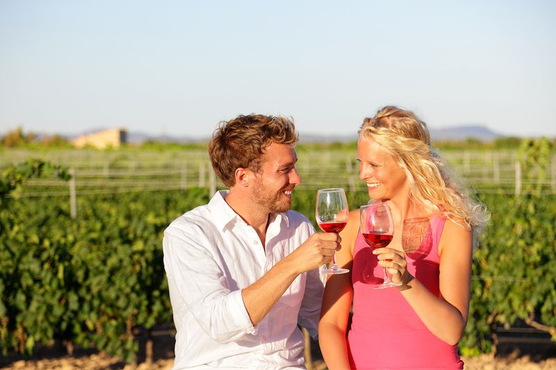 Bigstock-Red-wine-drinking-couple-toast-70996126